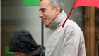 Daniel Day Lewis and his son walk in the rain in NYC 150154