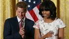 Prince Harry joins first lady Michelle Obama during an event to honor military families at the White House 150268