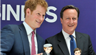 Prince Harry and PM David Cameron are presented with dolls of themselves by 'Makielab' company co-founder Jo Roach during part of a UK business campaign called 'GREAT' at the Milk Studios in Manhattan 150846