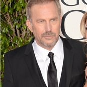 Kevin Costner and Christine Baumgartner on the red carpet at the 70th Annual Golden Globe Awards  136384