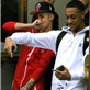 Justin Bieber and a friend dance their way out of his hotel and all the way onto his tour bus in Sweden  148137