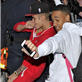 Justin Bieber and a friend dance their way out of his hotel and all the way onto his tour bus in Sweden  148142