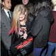 Avril Lavigne in London last night using a blanket to cover her body 128459