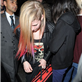 Avril Lavigne in London last night using a blanket to cover her body 128460