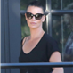 Charlize Theron catches a movie with mom in LA 134837
