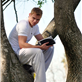 Kellan Lutz climbs a tree to read his book 129580