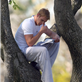 Kellan Lutz climbs a tree to read his book 129584