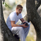 Kellan Lutz climbs a tree to read his book 129585