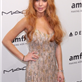 Lindsay Lohan with the dress still intact at the amfAR gala  140626