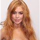 Lindsay Lohan with the dress still intact at the amfAR gala  140627