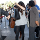 Selena Gomez hides her face as she prepares to depart LAX for New York  131644
