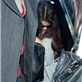 Selena Gomez hides her face as she prepares to depart LAX for New York  131645