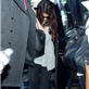 Selena Gomez hides her face as she prepares to depart LAX for New York  131647