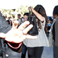 Selena Gomez hides her face as she prepares to depart LAX for New York  131648